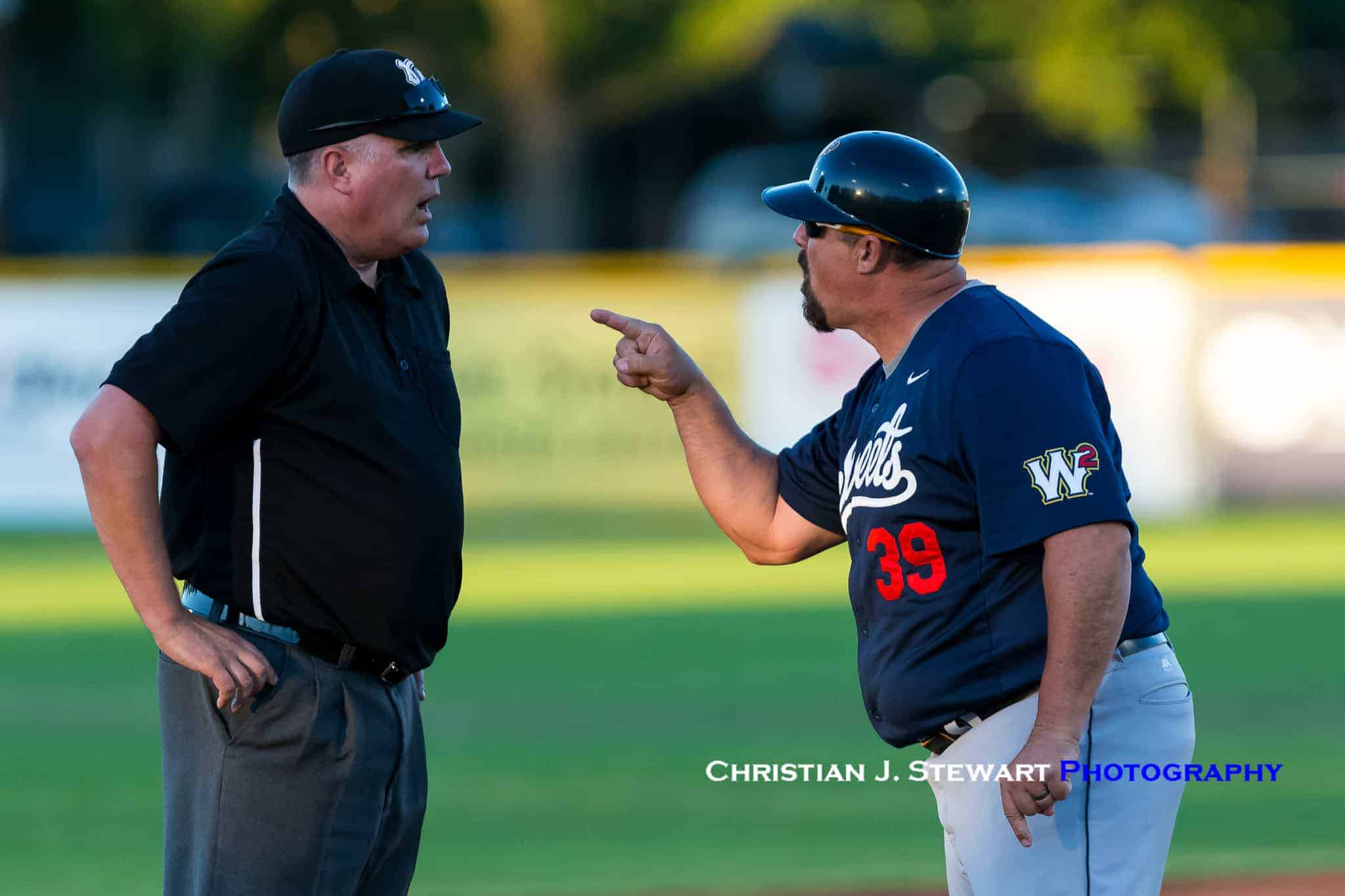 d14c661d4a3c4b Sweets  Manager Frank Mutz gives umpire Sean Sullivan a piece of his mind  after being ejected for arguing a close call at third base late in  Saturday s game ...